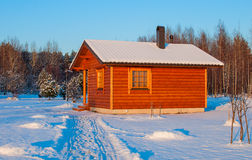 Wooden saun house in snow and frozen landscape Royalty Free Stock Image