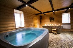 Wooden sauna. Bath with water in a beautiful wooden sauna Royalty Free Stock Images