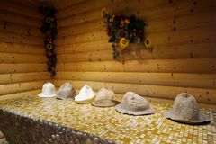 Wooden sauna. Caps from felt in a wooden sauna Royalty Free Stock Photography