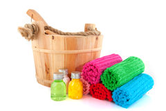 Wooden sauna bucket with colorful towels and soap Royalty Free Stock Photos