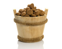 Wooden sauna bucket with dutch pepernoten Royalty Free Stock Images