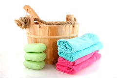 Wooden sauna bucket with towels and soap Stock Images
