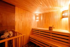 Wooden sauna in Finnish. Style with electric stove royalty free stock photo