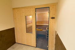 Wooden sauna with glass door Royalty Free Stock Photography