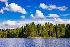 Wooden sauna log cabin at the lake in summer in Finland Royalty Free Stock Photography