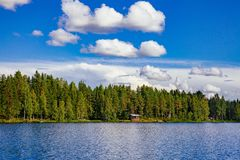 Wooden sauna log cabin at the lake in summer in Finland Royalty Free Stock Photo
