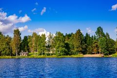 Wooden sauna log cabin at the lake in summer in Finland Stock Images