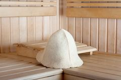 wooden sauna for relaxation with felt hat royalty free stock image