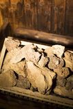 Wooden sauna rocks heater Stock Photography