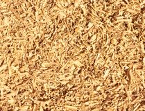 Wooden sawdust waste background texture. Wooden sawdust chips or fillings waste background texture, closeupu, copy space stock photography