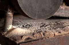 Wooden sawdust and electric grinding machine. Royalty Free Stock Photography