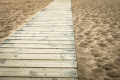 Wooden scaffold on the sandy beach of color sepia Royalty Free Stock Photos