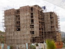 Wooden scaffolding is also used in the construction of tall buildings in Ethiopia. The Wooden scaffolding is also used in the construction of tall buildings in stock images
