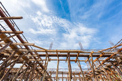 Wooden scaffolding low angle view at building site Stock Photography