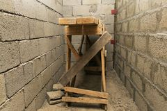 Wooden scaffolding standing in a niche. Old wooden scaffolding standing in a niche Stock Photos