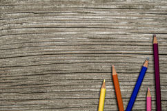 Wooden School Desk And Pencils. Back To School Image Of Some Colored Pencils On A Rustic Wooden Desk Royalty Free Stock Image