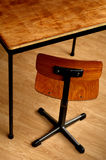 Wooden schooltable and chair. Focus on the seat Stock Image