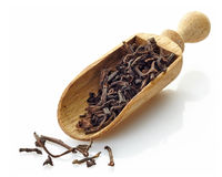 Wooden scoop with black tea Shu Puerh Royalty Free Stock Photo