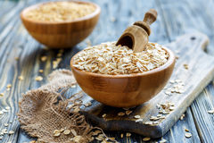 Wooden scoop in a bowl with oat flaks. Royalty Free Stock Photo