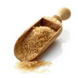 Wooden scoop with brown sugar Stock Photos