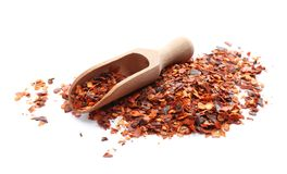 Wooden scoop and chili pepper flakes royalty free stock photos