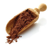 Wooden scoop with cocoa powder Stock Image