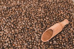 Wooden scoop on coffee beans background Stock Photography