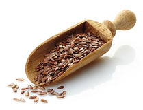 Wooden scoop with flax seeds Royalty Free Stock Photos