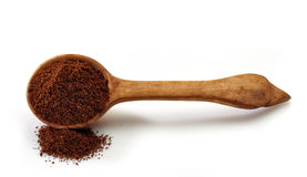 Wooden scoop with ground coffee Stock Images