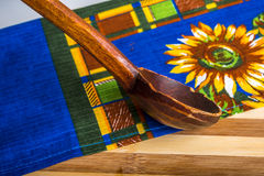 Wooden scoop on kitchen towel Royalty Free Stock Photography