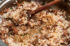 Wooden scoop in the minced meat with rice Stock Photos