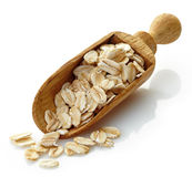 Wooden scoop with oat flakes Royalty Free Stock Image