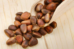 Wooden scoop with pine nuts Stock Photo