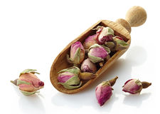 Wooden scoop with rose buds tea Royalty Free Stock Photos