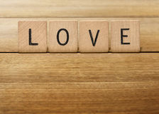 Wooden Scrabble Letter love. Use wooden scrabble letter to form a love Royalty Free Stock Images