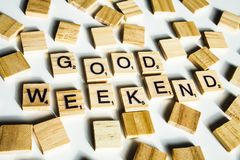 Wooden scrabble letters spelling the word GOOD WEEKEND on white stock photos