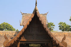 Wooden sculpture on ancient buddhism temple gable Stock Photos