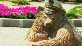 A wooden sculpture of a bear stock video footage