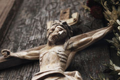 A wooden sculpture of crucified Jesus Christ  (styled retro) Stock Photo