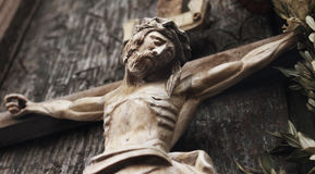 A wooden sculpture of crucified Jesus Christ  (styled retro). Jesus Christ crucified (an ancient wooden sculpture) (details Stock Images