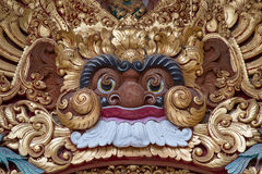 Wooden sculpture of the demon in the temple in Ubud, Bali, Indonesia Royalty Free Stock Photography