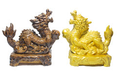 Wooden sculpture dragon and sculptrue gold dragon on a white background. Stock Photo