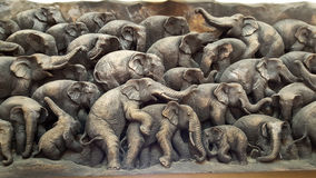 Wooden sculpture of elephant family Stock Photo