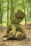 Wooden Sculpture of a Hand a Wood. Wooden Sculpture of a Hand in  a Wood Stock Photo