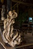 Wooden sculpture made  of raw roots of Cambodian tree. Wooden sculpture made  of raw roots of Cambodian tree standing in the garden Stock Images