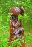 Wooden sculpture of musician in Dendrology garden in Pereslavl-Zalessky city Stock Photos
