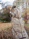 Wooden sculpture in city park. OWL. royalty free stock image