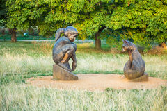 Wooden sculptures - girl and fox Stock Images