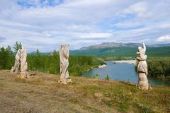 Wooden sculptures over the Sob river, Yamal. Wooden sculptures over the Sob river on a sunny August day, Yamalo-Nenets Autonomous okrug stock photo