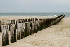 Wooden sea breakers Stock Photos